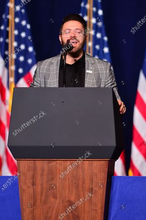 Danny Gokey reciting the United States national anthem during the 'Evangelicals for Trump' Coalition Launch at the King Jesus International Ministry