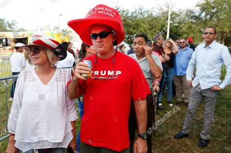 Christine Gautier, Jamie Klein, Andrew Gillum. Christine Gautier, left, and Jamie Klein wait outside the King Jesus International Ministry for a rally with President Donald Trump, in Miami