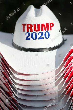 Andrew Gillum. A stack of Trump 2020 hats are stacked at a vender's stall outside the King Jesus International Ministry, before a rally with President Donald Trump, in Miami