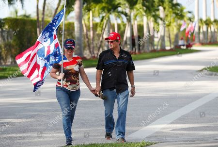 Cheryl Diaz, Graham Harward, Andrew Gillum. Cheryl Diaz, left, and Graham Harward walk towards the King Jesus International Ministry, as they arrived for a rally with President Donald Trump, in Miami