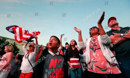 Andrew Gillum. Trump suporters cheer as they watch President Donald Trump on a large screen in an overflow area outside the King Jesus International Ministry, during a rally with Trump, in Miami