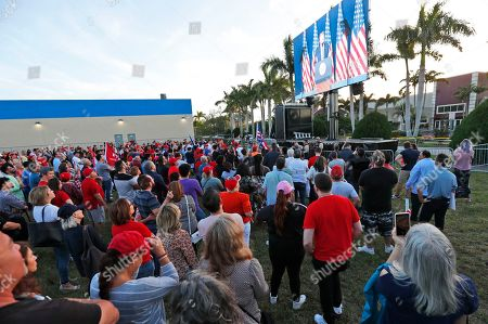Andrew Gillum. Attendees watch President Donald Trump on a large screen in an overflow area outside the King Jesus International Ministry, during a rally with the president, in Miami
