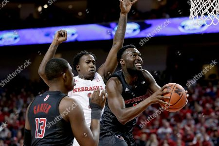 Akwasi Yeboah, Kevin Cross, Shaq Carter. Rutgers' Akwasi Yeboah, right, goes to the basket in front of Nebraska's Kevin Cross (1), as Shaq Carter (13) watches during the first half of an NCAA college basketball game in Lincoln, Neb