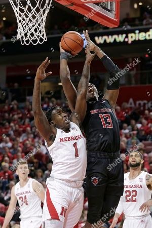 Shaq Carter, Kevin Cross. Rutgers' Shaq Carter (13) goes for a basket against Nebraska's Kevin Cross (1) during the first half of an NCAA college basketball game in Lincoln, Neb