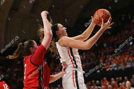 Oregon State's Taylor Jones (44) shoots as Utah's Andrea Torres (3) defends during the second half of an NCAA college basketball game in Corvallis, Ore., . Oregon State won 77-48