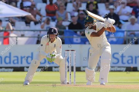 South African batsman Vernon Philander bats while England wicketkeeper Jos Buttler watches on during day two of the second cricket test between South Africa and England at the Newlands Cricket Stadium in Cape Town, South Africa