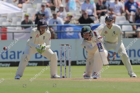 South African batsman Rassie van der Dussen in action while England wicketkeeper Jos Buttler watches on during day two of the second cricket test between South Africa and England at the Newlands Cricket Stadium in Cape Town, South Africa