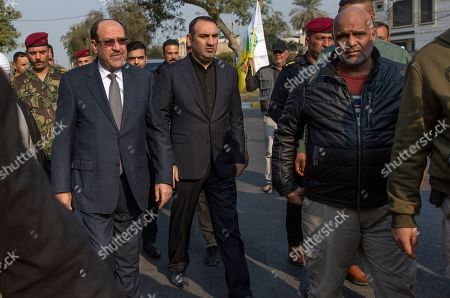 """Former Iraqi Prime Minister Nouri al-Maliki takes part in the funeral of Iran's top general Qassem Soleimani and Abu Mahdi al-Muhandis, deputy commander of Iran-backed militias in Iraq known as the Popular Mobilization Forces, in Baghdad, Iraq, . Thousands of mourners chanting """"America is the Great Satan"""" marched in a funeral procession Saturday through Baghdad for Iran's top general and Iraqi militant leaders, who were killed in a U.S. airstrike"""