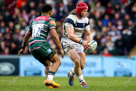 Harry Thacker of Bristol Bears takes on Kyle Eastmond of Leicester Tigers