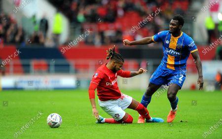 Kasey Palmer of Bristol City tackles Aaron Pierre of Shrewsbury Town- Mandatory by-line: Nizaam Jones/JMP