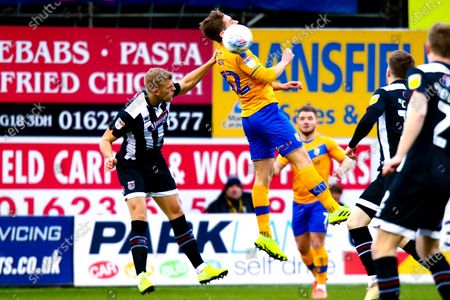 Danny Rose of Mansfield Town gets a head to the ball