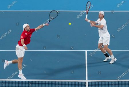 Oliver Marach and Juergen Melzer of Austria in action during their doubles match against Croatia during day 2 of the ATP Cup tennis tournament at Ken Rosewall Arena in Sydney, Australia, 05 January 2020.