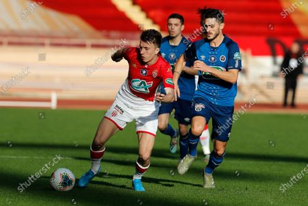 Aleksandr Golovin (L) of AS Monaco and Xavier Chavalerin (R) of Reims in action during the French Cup round of 32 soccer match, AS Monaco vs Stade de Reims, at Stade Louis II, in Monaco, 04 January 2020.