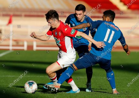 Aleksandr Golovin (L) of AS Monaco and Tristan Dingome (R) of Reims in action during the French Cup round of 32 soccer match, AS Monaco vs Stade de Reims, at Stade Louis II, in Monaco, 04 January 2020.
