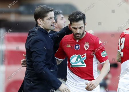 AS Monaco's Spanish head coach Robert Moreno (L) and Spanish player Cesc Fabregas (R) during the French Cup round of 32 soccer match, AS Monaco vs Stade de Reims, at Stade Louis II, in Monaco, 04 January 2020.
