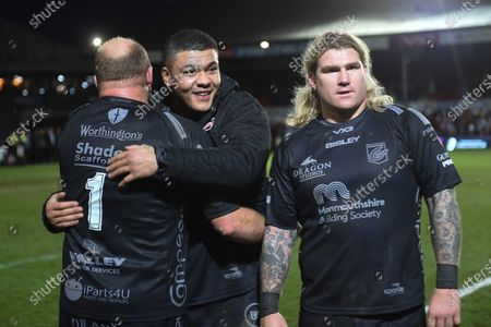 Brok Harris of Dragons and Leon Brown of Dragons and Richard Hibbard of Dragons celebrate their win