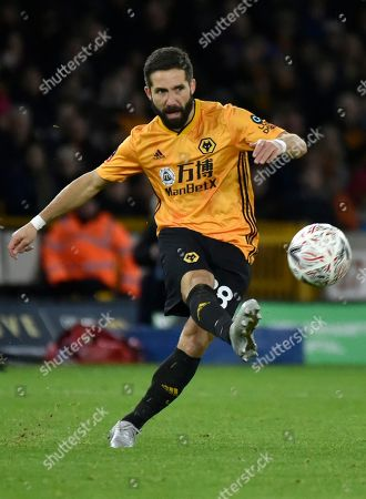 Wolverhampton Wanderers' Joao Moutinho kicks the ball during the English FA Cup third round soccer match between Wolverhampton Wanderers and Manchester United at the Molineux Stadium in Wolverhampton, England