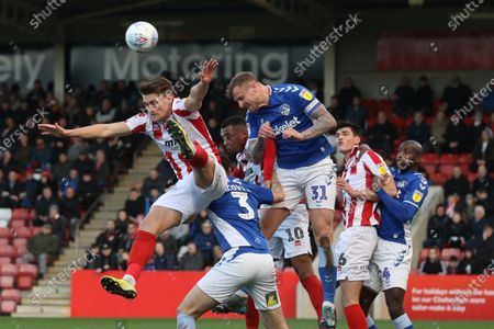 Charlie Raglan, Alex Iacovitti and David Wheater during the EFL Sky Bet League 2 match between Cheltenham Town and Oldham Athletic at Jonny Rocks Stadium, Cheltenham
