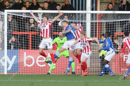 Charlie Raglan, David Wheater and Ben Tozer during the EFL Sky Bet League 2 match between Cheltenham Town and Oldham Athletic at Jonny Rocks Stadium, Cheltenham