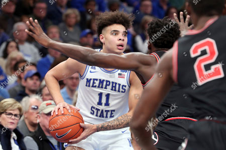 Stock Photo of Memphis guard Lester Quinones (11) looks to pass around Georgia guard Anthony Edwards (5) in the second half of an NCAA college basketball game, in Memphis, Tenn