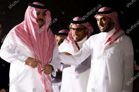 Stock Image of Governor of Jeddah Prince Mishaal Bin Majid Al Saud (L) and Saudi General Sport Authority Chairman Prince Abdulaziz bin Turki-Al-Faisal (R) arrive to attend the podium ceremony a day before the departure of the Rally Dakar 2020, in Jeddah, Saudi Arabia, 04 January 2020. The Rally Dakar takes place in Saudi Arabia from 05 to 17 January 2020.