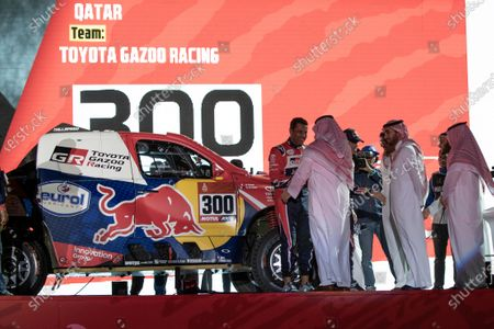 Qatari Naser Al-Attiyah (Toyota Gazzo Racing) checks hand with the Governor of Jeddah Prince Mishaal Bin Majid Al Saud (3-R) next to Saudi General Sport Authority Chairman Prince Abdulaziz bin Turki-Al-Faisal (2-R) during the podium ceremony a day before the departure of the Rally Dakar 2020, in Jeddah, Saudi Arabia, 04 January 2020. The Rally Dakar takes place in Saudi Arabia from 05 to 17 January 2020.