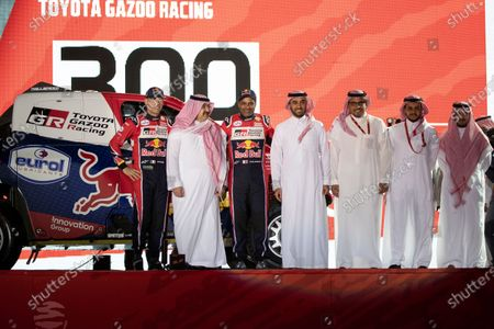 (L) Co-driver Matthieu Baumel from France, (2-L) Governor of Jeddah Prince Mishaal Bin Majid Al Saud, car driver Qatari Naser Al-Attiyah (C), Prince Abdulaziz bin Turki-Al-Faisal (2-R) pose for a photograph during the podium ceremony a day before the departure of the Rally Dakar 2020, in Jeddah, Saudi Arabia, 04 January 2020. The Rally Dakar takes place in Saudi Arabia from 05 to 17 January 2020.