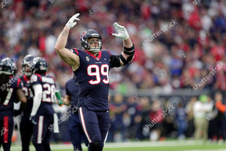 Houston Texans defensive end J. J. Watt (99) encourages the fans to make noise during the first half of an NFL wild-card playoff football game against the Buffalo Bills, in Houston