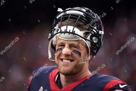 Houston Texans defensive end J. J. Watt on the sidelines during the first half of an NFL wild-card playoff football game against the Buffalo Bills, in Houston