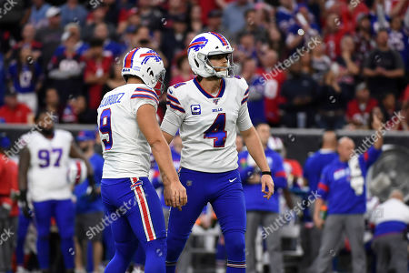 Buffalo Bills kicker Steven Hauschka (4) celebrates with Corey Bojorquez (9) after kicking a field goal against the Houston Texans during the first half of an NFL wild-card playoff football game, in Houston