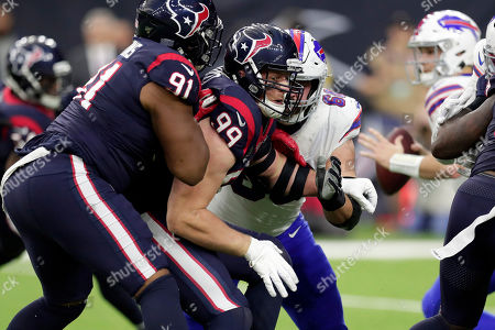 Houston Texans defensive end J. J. Watt (99) rushes against the Buffalo Bills during the first half of an NFL wild-card playoff football game, in Houston