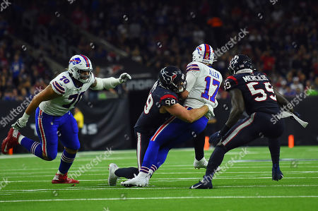 Buffalo Bills quarterback Josh Allen (17) is sacked by Houston Texans defensive end J. J. Watt (99) during the second half of an NFL wild-card playoff football game, in Houston