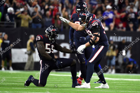 Houston Texans outside linebacker Whitney Mercilus (59) celebrates with J. J. Watt (99) after forcing a fumble by Buffalo Bills quarterback Josh Allen during the second half of an NFL wild-card playoff football game, in Houston