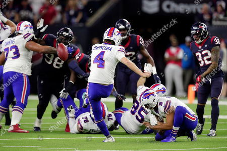 Buffalo Bills kicker Steven Hauschka (4) kicks a field goal to tie the game during the second half of an NFL wild-card playoff football game against the Houston Texans, in Houston