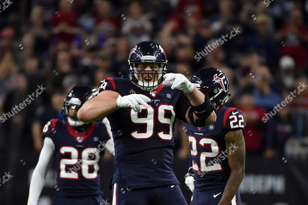 Houston Texans defensive end J. J. Watt (99) celebrates during the second half of an NFL wild-card playoff football game against the Buffalo Bills, in Houston
