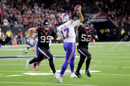 Buffalo Bills quarterback Josh Allen (17) is pressured by Houston Texans' J. J. Watt (99) and Barkevious Mingo (52) during the second half of an NFL wild-card playoff football game, in Houston
