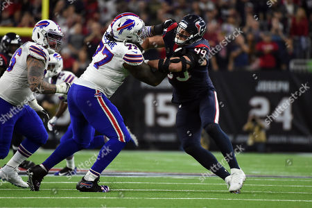 Buffalo Bills offensive tackle Ty Nsekhe (77) blocks Houston Texans defensive end J. J. Watt (99) during the second half of an NFL wild-card playoff football game against the Buffalo Bills, in Houston