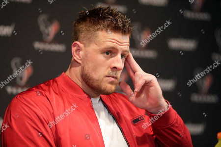 Stock Picture of Houston Texans defensive end J. J. Watt answers a question during a news conference after an NFL wild-card playoff football game against the Buffalo Bills, in Houston. The Texans won 22-19 in overtime