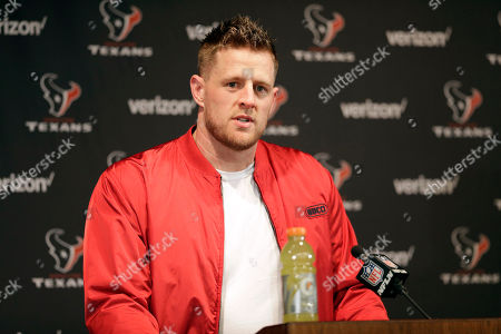 Houston Texans defensive end J. J. Watt answers a question during a news conference after an NFL wild-card playoff football game against the Buffalo Bills, in Houston. The Texans won 22-19 in overtime