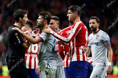 Atletico de Madrid's forward Alvaro Morata (2-R) and Levante's defender Coke Andujar (2-L) react during the Spanish LaLiga soccer match between Atletico de Madrid and Levante UD at Wanda Metropolitano stadium in Madrid, Spain, 04 January 2020.
