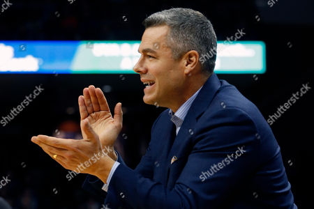 Virginia head coach Tony Bennett directs his team during the first half of an NCAA college basketball game against Virginia Tech in Charlottesville, Va
