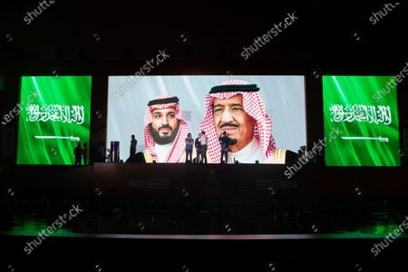 The picture of the Saudi Arabia's King Salman bin Abdulaziz Al Saud (R) and Crown Prince Mohammed bin Salman (L) are displayed on a screen during the Saudi National Anthem, Podium Ceremony of departure of the Dakar Rally 2020, in Jeddah, Saudi Arabia, 04 January 2020. The Rally Dakar takes place in Saudi Arabia from 05 to 17 January 2020.