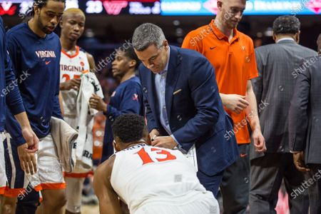 Virginia Cavaliers head coach Tony Bennett shows a play to Virginia Cavaliers guard Casey Morsell (13) in a timeout during NCAA basketball action between the Virginia Tech Hokies and the Virginia Cavaliers at John Paul Jones Arena Charlottesville, VA