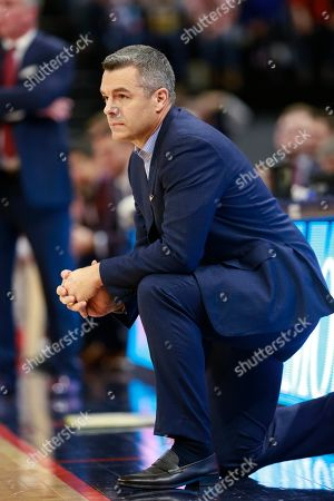 Virginia head coach Tony Bennett watches play during the first half of an NCAA college basketball game in Charlottesville, Va., . Virginia defeated Virginia Tech 65-39