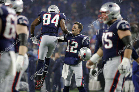 Stock Picture of New England Patriots quarterback Tom Brady (12) gets fired up with tight end Benjamin Watson (84) up before an NFL wild-card playoff football game against the Tennessee Titans, in Foxborough, Mass