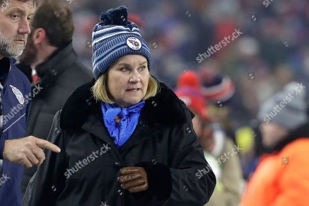 Stock Photo of Tennessee Titans owner Amy Adams Strunk walks on the field before an NFL wild-card playoff football game against the New England Patriots, in Foxborough, Mass