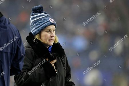 Tennessee Titans owner Amy Adams Strunk walks on the field before an NFL wild-card playoff football game against the New England Patriots, in Foxborough, Mass