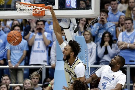 Georgia Tech forward James Banks III (1) dunks next to North Carolina guard Brandon Robinson (4) during the first half of an NCAA college basketball game in Chapel Hill, N.C
