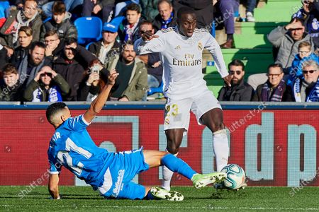 Ferland Mendy of Real Madrid and Faycal Fajr of Getafe FC