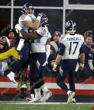 Tennessee Titans tight end Anthony Firkser (L) celebrates with teammate Rodger Saffold II (C) as quarterback Ryan Tannehill (R) runs towards them after a touchdown against the New England Patriots in the first quarter of their AFC Wild Card playoff game at Gillette Stadium in Foxborough, Massachusetts, USA, 04 January 2020.